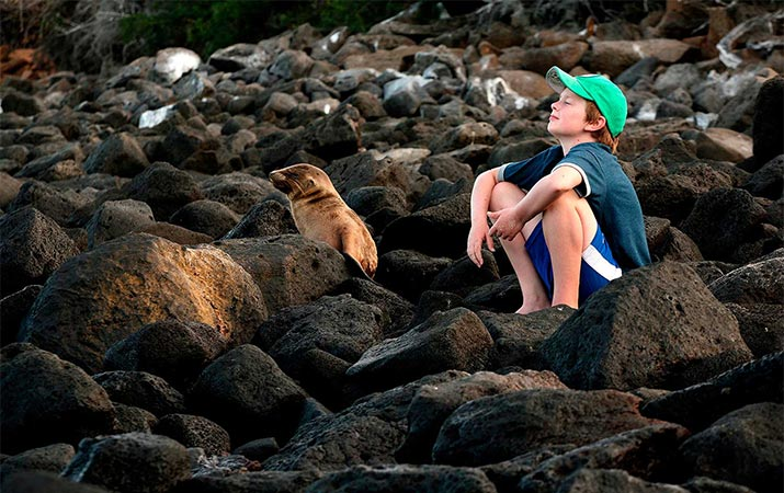 classic-journeys-galapagos-boy-sea-lion-715